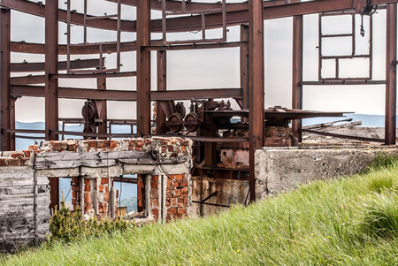 chair on the lift: ruins of chair lift top station on Krizna hill in Velka Fatra mountains in Slovakia