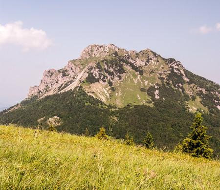 mala fatra: rocky Velky Rozsutec hill in Mala Fatra mountain range with mountain meadows bellow