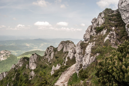 mala fatra: hiking trail with dolomitian rocks around and blue sky with clouds on Velky Rozsutec hill in Mala Fatra mountains