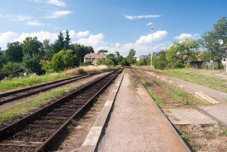 regional: railway platform and tracks on Kraliky railway station on regional railroad in Czech republic
