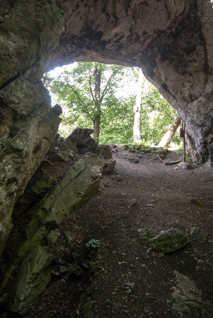 natural arch: view through Aksamitova brana natural arch on Kotyz hill in Cesky kras in Central Bohemia Stock Photo
