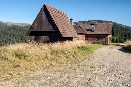 wooden hut: Frantiskova myslivna wooden hut in Jeseniky mountains with clear sky Stock Photo