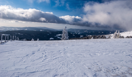 alpen: winter Fischbacher Alpen mountain range panorama in Styria with snow and blue sky with clouds Stock Photo