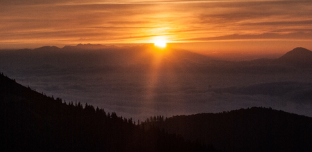 sunrise above Tatras mountain range with colorful sky from Chata pod Chlebom in Mala Fatra mountains in Slovakia