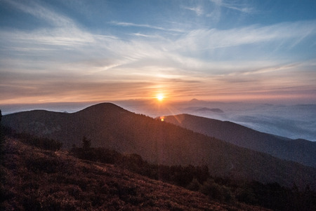 mala fatra: sunrise above mountains with colorful sky from Chata pod Chlebom chalet in Mala Fatra mountains in Slovakia