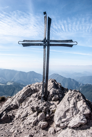 mala fatra: Velky Rozsutec hill summit with cross, rocks and blue sky with clouds in autumn Mala Fatra mountains in Slovakia