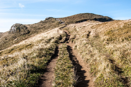 mala fatra: hiking trail to Chleb hill on mountain meadow with small rocks and clear sky in autumn Mala Fatra mountains in Slovakia