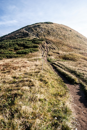mala fatra: Hromove hill with hiking trail, mountain meadow and blue sky in autumn Mala Fatra mountains in Slovakia Stock Photo