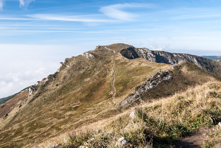 mala fatra: Chleb hill in autumn Mala Fatra mountains in Slovakia with mountain meadow, cliffs and blue sky Stock Photo