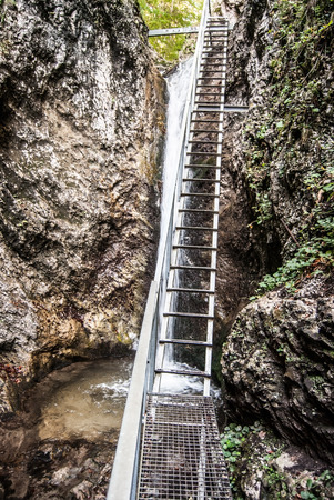 mala fatra: Janosikove diery gully in Mala Fatra mountains in Slovakia with ladder on hiking trail, waterfall and rocks Stock Photo