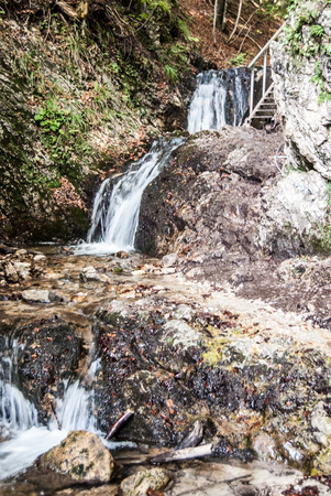 mala fatra: series of waterfalls with rocks and ladder on hiking trail in Janosikove diery gully in Mala Fatra mountains in Slovakia Stock Photo