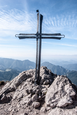 mala fatra: Velky Rozsutec hill summit with rocks, cross and blue sky with clouds in autumn Mala Fatra mountains in Slovakia