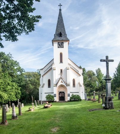 lipno: church with cemetery in former village Zadni Zvonkova in Sumava mountains near Lipno water reservoir
