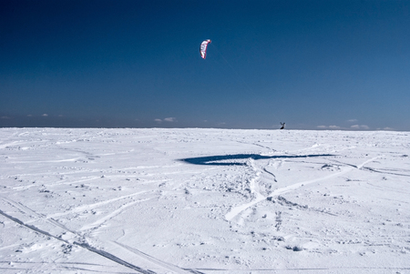 snowkiting: snowkiting on Vysoka hole in winter Jeseniky mountains with clear sky Stock Photo