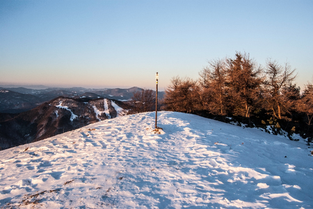 mala fatra: Revan hill above Fackovske sedlo in southernmost part of Mala Fatra mountains with snow, trees and clear sky during winter morning