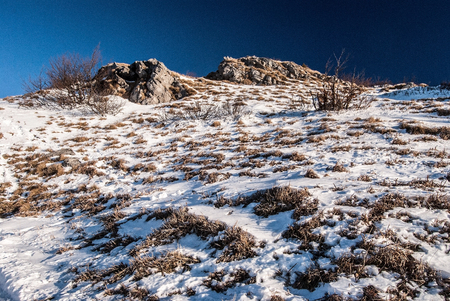 mala fatra: rocky Klak hill with snow and clear sky insouthernmost part of Mala Fatra mountains during winter Stock Photo