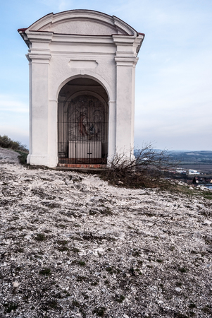 chapel on Stations of the cross from Mikulov to Svaty Kopecek hill in Palava mountains in South Moravia in Czech republic during spring day with blue sky