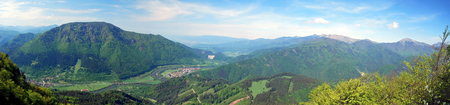 spectacular panorama with Vah river valley with few villages, Velka Fatra and Mala Fatra mountain range and blue sky with clouds from view point near Zadny Sip hill in Velka Fatra mountains in Slovakia