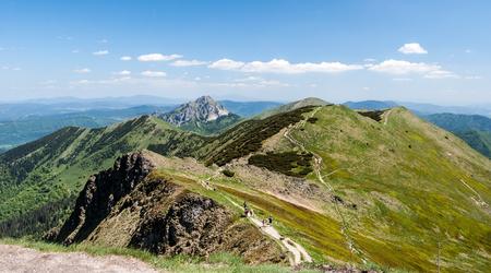 panorama of Krivanska Mala Fatra mountain range with Hromove, Steny, Poludnovy grun, Stoh, Velky Rozsutec and Maly Rozsutec hill from Chleb hill summit in Slovakia Stock Photo