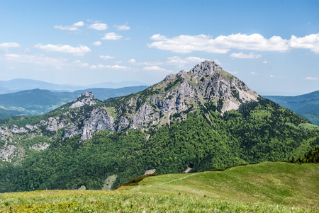 Maly Rozsutec and Velky Rozsutec rocky dolomitian hills with lower mountain ridge between Steny and Poludnovy grun hills with hiking trail in Mala Fatra mountains in Slovakia