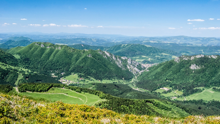 view to Vratna dolina valley with hills around  from Poludnovy Grun hill in Mala Fatra mountains in Slovakia Stock Photo