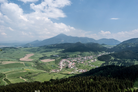 Komkatna village with nice countryside around and Chocske vrchy mountain range with Velky Choc hill on the background from Hrdosna skala hill in Velka Fatra mountains in Slovakia Stock Photo