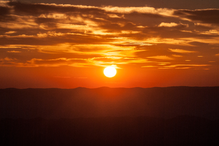 sunset from Horna luka hill in Mala Fatra mountains in Slovakia with hills, sun and colorful sky
