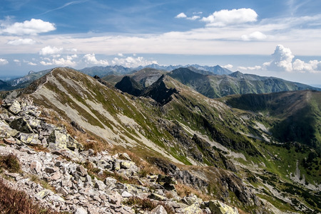 Spectacular panorama of Tatras mountain range from Banikov peak in Rohace mountain group in Slovakia during nice day with blue sky and clouds Stock Photo