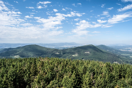 view from Velky Javornik hill near Frenstat pod Radhostem city in Moravskoslezske Beskydy mountains in Czech republic during nice summer day with blue sky and few clouds