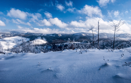 winter Beskids mountains panorama with snow, hills and blue sky with clouds from hiking trail near Velka Raca hill in Kysucke Beskydy mountains on slovakian - polish borders Stock Photo