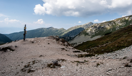 Ziarske sedlo mountain pass with guidepost and peaks on the background in Western Tatras mountains in Slovakia Stock Photo