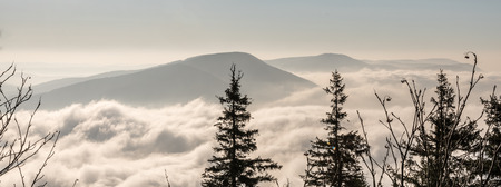Smrk, Knehyne and Radhost hill from Lysa hora hill in autumn Moravskoslezske Beskydy mountains in Czech republic with clouds and clear sky above
