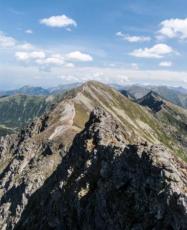 spectacular Tatra mountains panorama with many peaks of Zapadne and Vysoke Tatry mountains from sharp ridge between Banikov and Hruba kopa mountain peaks on Rohace mountain group in Zapadne Tatry mountains in Slovakia
