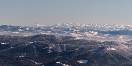 view to part of Zapadne Tatry, whole Vysoke and Belianske Tatry from Lysa hora hill in winter Moravskoslezske Beskydy mountains in Czech republic