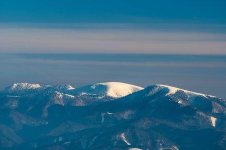 Cierny kamen, Ploska and Borisov hills in Velka Fatra mountains from Martinske hole in Mala Fatra mountains in Slovakia during beautiful winter day Reklamní fotografie