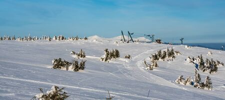 Martinske hole (Martinky) ski resort above Martin town in Slovakia during amazing winter day with blue sky