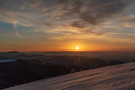 sunset from Veterne hill on Martinske hole in Mala Fatra mountains in Slovakia during winter with colorful sky