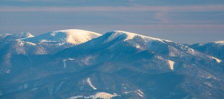 Borisov, Ploska and Cierny kamen hills in Velka Fatra from Martinske hole in Mala Fatra mountains in Slovakia during beautiful winter day with blue sky