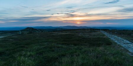 view from Vysoka plan hill in Krkonose mountains on czech-polish border during summer sunset