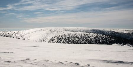 Petrovy kameny rock formation and Vysoka hole hill from Praded hill in Jeseniky mountains in Czech republic during windy winter day Stok Fotoğraf