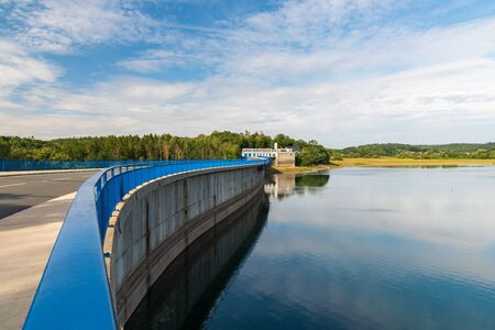 dam of Talsperre Pohl water reservoir with road near Plauen city in Germany