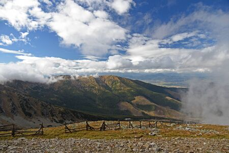 View from Chopok hill in Nizke Tatry mountains in Slovakia during autumn day with blue sky and clouds