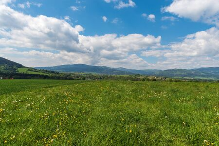 Beautiful surrounding of Jablunkov town in Czech republic with rual landscape and hills during springtime day with blue sky and clouds