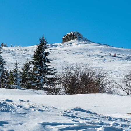 Petrovy kameny rock formation in Jeseniky mountains in Czech republic during freezing winter day with clear sky