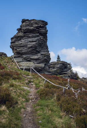 Vozka hill with rock formations and hiking trail in Jeseniky mountains in Czech republic