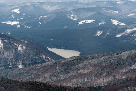 View to Sance water reservoir with hills around from hiking trail bellow Lysa hora hill summit in winter Moravskoslezske Beskydy mountains in Czech republic Reklamní fotografie