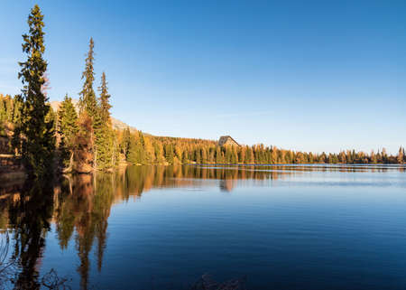 Strbske pleso lake in Vysoke Tatry mountains in Slovakia during autumn afrernoon with clear sky
