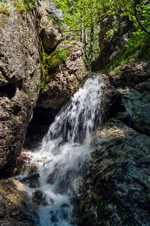 Waterfall with rocks and trees around on Horne diery gorge in Mala Fatra mountains near Terchova village in Slovakia