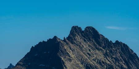 Two summits Vysoka mountain peak with lowest Tazky stit mountain peak in autumn Vysoke Tatry mountains in Slovakia Reklamní fotografie
