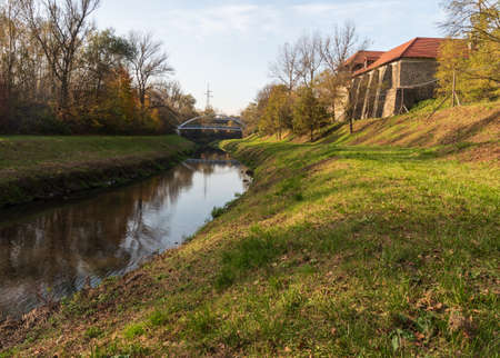 Slezskoostravsky hrad castle with Lucina river in Ostrava city in Czech republic during beautiful autumn day Reklamní fotografie